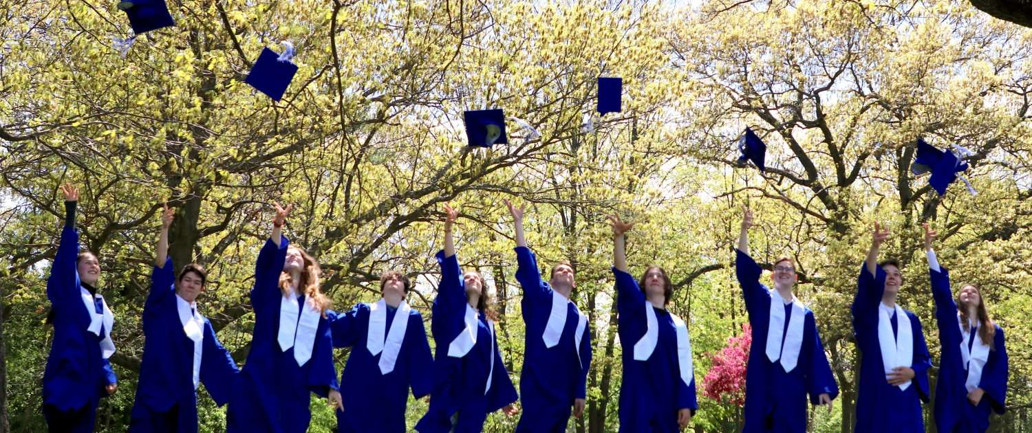 Students throwing their graduation caps in the air