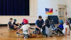 Students learning to skateboard at German International School Boston