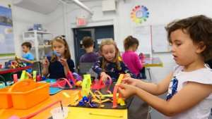 Students making art projects at German International School Boston