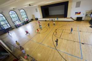Students playing dodgeball at German International School Boston