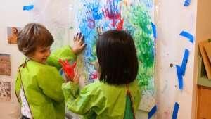 Children finger painting at German International School Boston