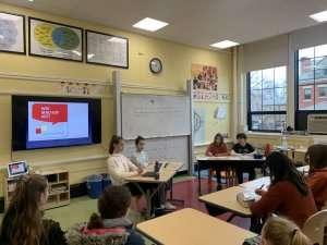 Students presenting in class at German International School Boston