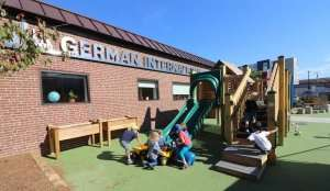 Students climbing on jungle gym at German International School Boston