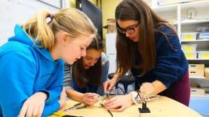 Students solding in class at German International School Boston